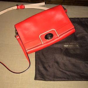 Neon orange leather crossbody bag